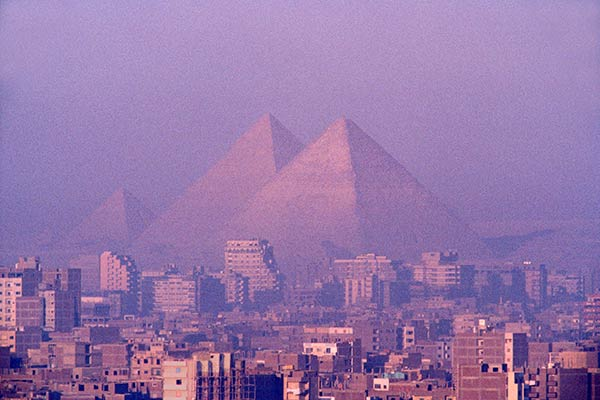 Pyramids of Giza, soaring above the city of Cairo, Egypt