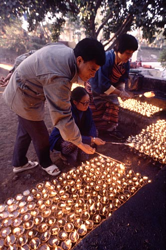 Buddhist Pilgrims lighting candles, Bodh Gaya