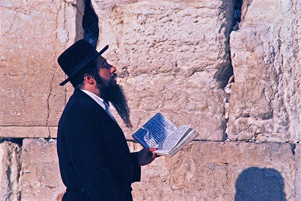Hasidic Jew praying at the Western Wall in Jerusalem